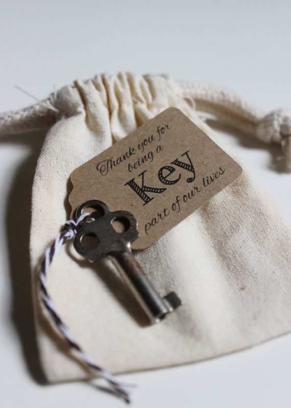 Thank you for being a Key part of our lives or special day. Love is the Key, wedding favor tags for small antique key wedding favors or key bottle opener escort cards.