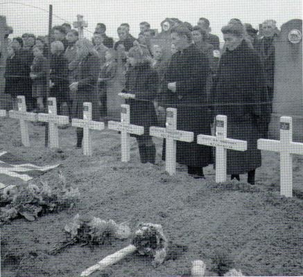 Dutch civilians attending the burial of fifty-five Canadian Soldiers, all members of Canada's Black Watch Regiment.