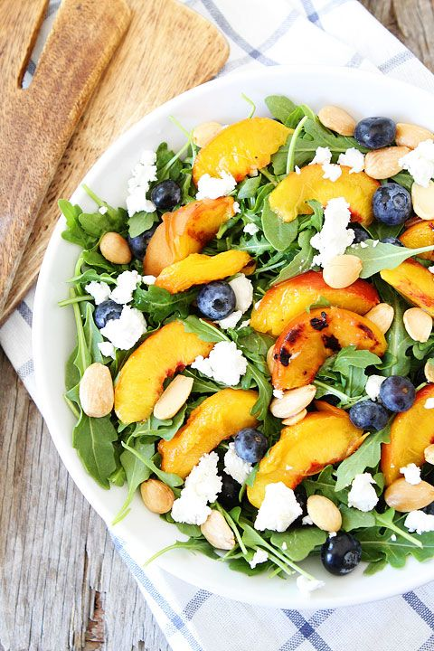Grilled Peach, Blueberry, and Goat Cheese Arugula Salad Recipe on twopeasandtheirpod.com This simple summer salad is SO good!
