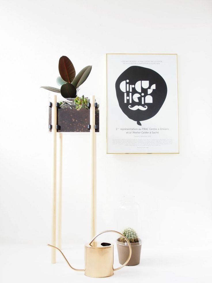 Assemble a skyscraper of a planter using wooden dowels.