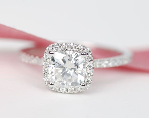 1.4ct center stone .25 ct side stones cushion cut halo. Oh helllloooo