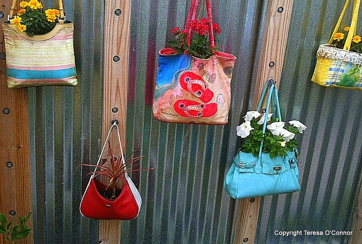 Hanging purses give a whimsical touch to vertical gardening. Seen at Naples Botanical Garden in the Children's Garden. More options for every style...: Unwanted Purses, Helmets Repurposed, Gardens Accessories, Also Old Bike, Old Bikes, Hanging Planters, Hanging Purses, Bike Helmets, Botanical Gardens