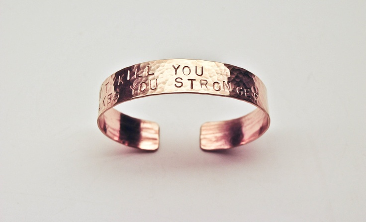"""What doesn't kill you makes you stronger"" cuff bracelet. I like the"