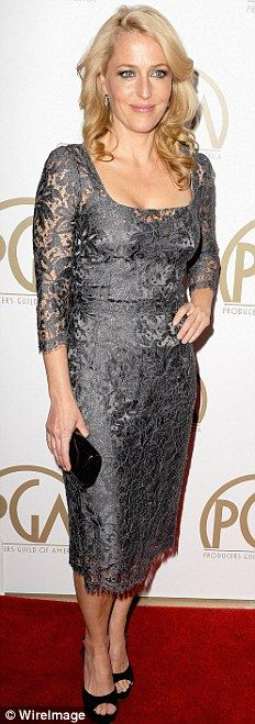 Lovely in lace: Gillian Anderson sported a pretty long sleeved grey dress with peep toe black heels