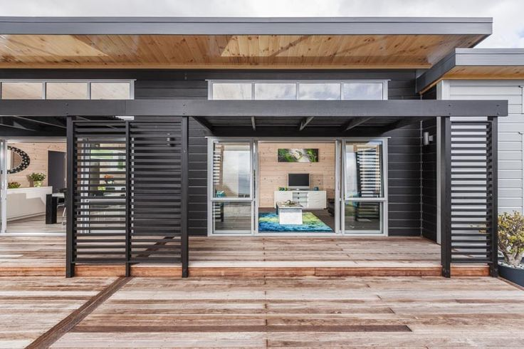 Louvres on the decks, with high clerestories, black painted VG laminated pine mixed with aluminium low maintenance exterior on this Lockwood show home in Takanini