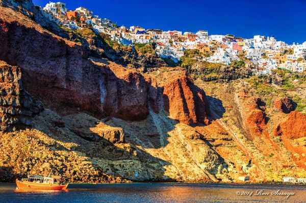 Wild caldera and Oia village on top, Santorini island