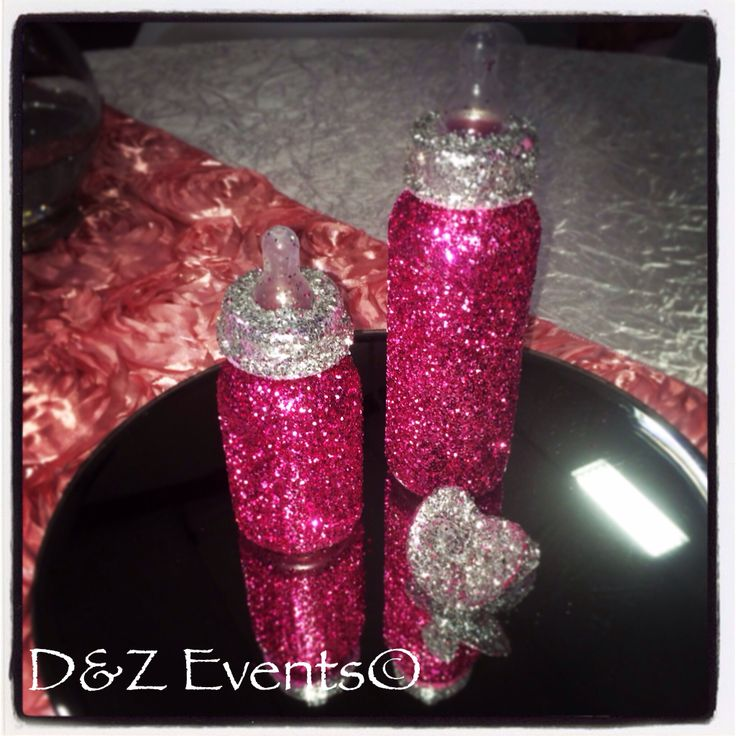 Glittery bottle centerpieces for a baby shower.