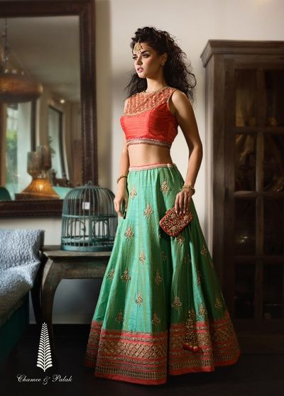 orange sleeveless blouse, brocade work on blouse, raw silk lehenga, pastel green lehenga, orange border lehenga, scattered motif