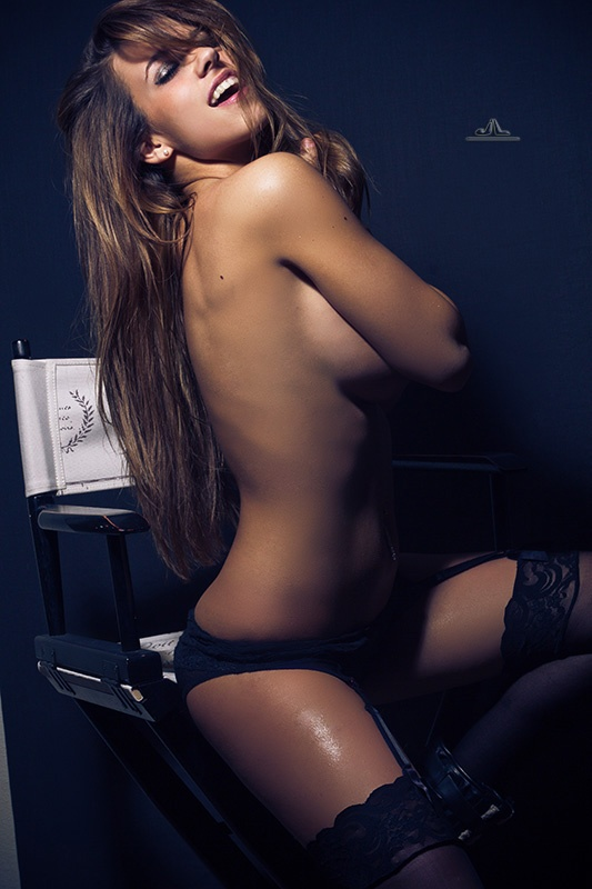 Simple Boudoir in studio - dark background, directors chair and single light - model Carlye Denise on ModelMayhem