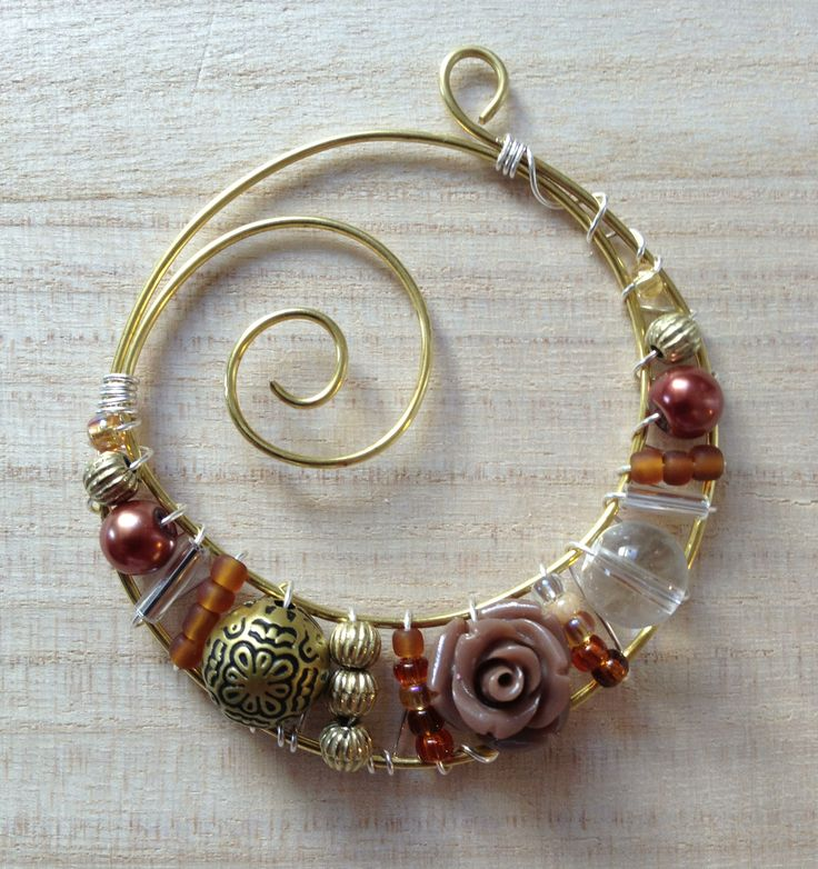 Idean: Make this form and insert the beads or wire shapes. Then cut off the excess wire area that doesn't have beads. Not there is a crescent moon shape. www.lindasinish.com Just the IMAGE. But great Wire wrapped pendant INSPIRATION More
