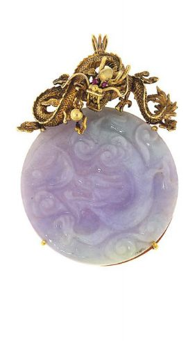 A jadeite jade pendant The circular very pale lilac and green jade panel craved to depict a dragon, to a dragon surmount with ruby eyes, panel 5.2cm wide, pendant 7.6cm long, jade not tested for natural colour and other treatments.
