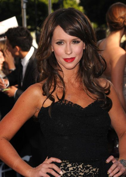 Hair Lookbook: Jennifer Love Hewitt wearing Long Curls with Bangs (3 of 11). Jennifer let her hair down and sported saucy, tousled curls with side-swept swing bangs and red-hot lipstick.