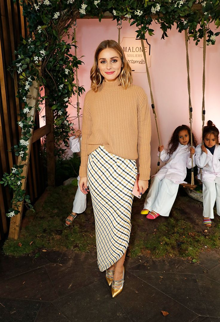 Asymmetrical Skirt On Olivia Palermo - An elegant yet fashion-forward separate that's easy to team with anything from ruffled blouses to nubby turtlenecks à la Olivia, the asymmetrical skirt is a staple this season.