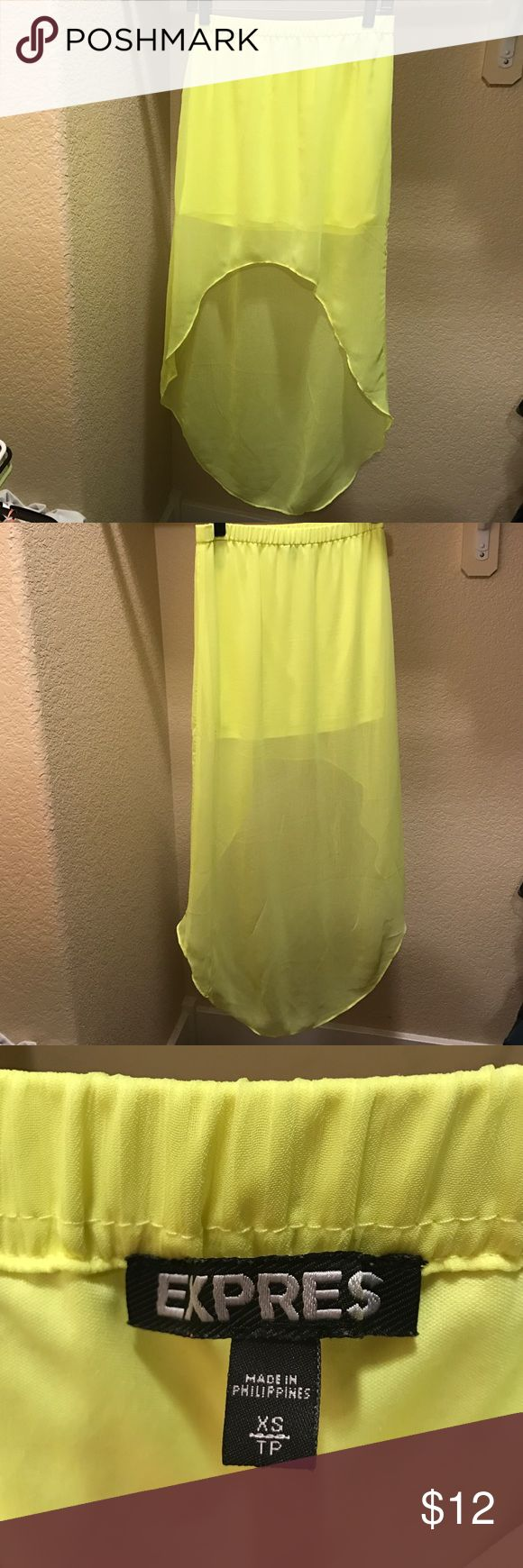 Bright neon yellow Epress high low skirt size XS Bright neon yellow Express high low skirt. Pairs well with a black ribbed tank top and sandals. Perfect for tropical destinations. Made from 100% polyester. No snags or stains. Great condition. Express Skirts High Low