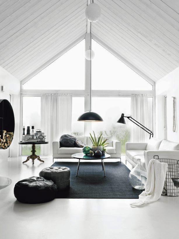 White on white. White floors and black and white livingroom