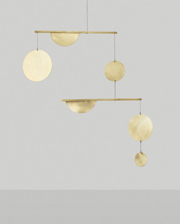 Forged by hand by Dallas-based maker Corie Humble, these brass mobiles are each slightly unique in order to achieve perfect balance. With gorgeous angles and subtle reflection of light, Circle and Line mobiles become a focal point of any space.The mobiles have been coated in three layers of lacquer, but will patina with time, which is the beauty of working with a natural material. Please allow 2-3 weeks lead time on this piece. SPECIFICATIONS 32 H x 33W MATERIAL Solid Brass and Lacquer CARE…