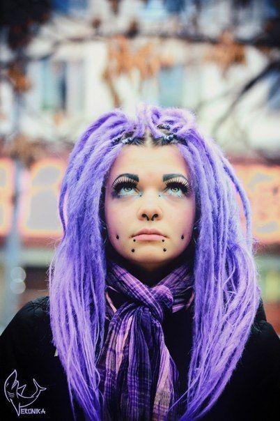 Light Purple Dreads And Cool Face Piercings Cheek