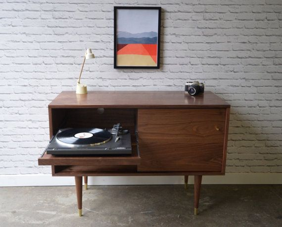 The perfect piece to for elegant vinyl lovers. Record player pull out shelf on left, record storage on right and a sliding door to allow easy access