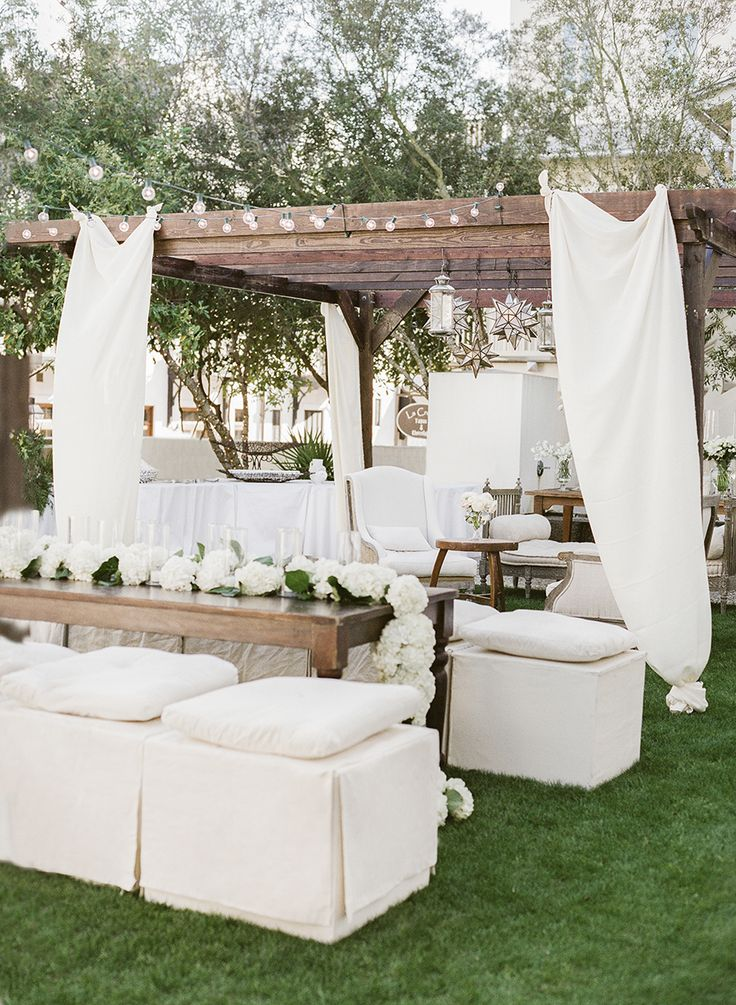 Elegant white reception decor: http://www.stylemepretty.com/2016/06/20/steal-the-look-morgan-stewarts-glam-all-white-wedding/