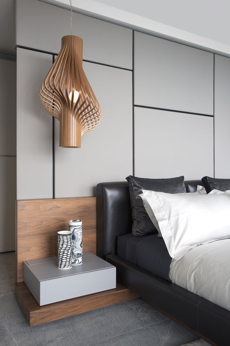 Modern bedroom accessories - In This Modern Master Bedroom Sculptural Wood Pendant Lights Act As Bedside Lamps While The Bathroom Is Completely Open To The Bedroom