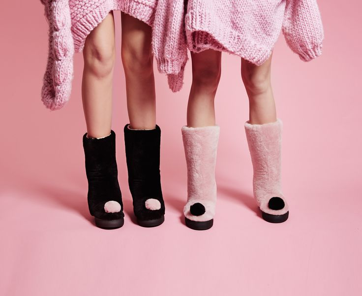 Cute and cosy! Keep your toes warm with soft shearling boots - the icing on the cake, a cute pompom sits atop the toe. Minna Parikka's Roxy in black and pale pink.