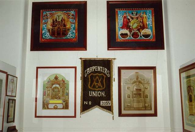 Part of the display, Lorna Morrison Room, Sydney Trades Halll. Image of Engineers banner, US Carpenters banner, certificates
