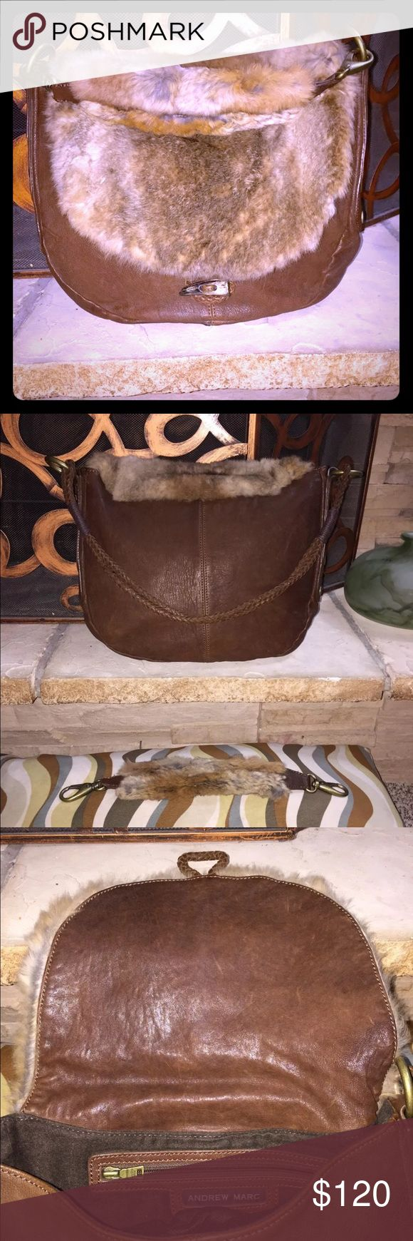 Beautiful Andrew Marc Brown Leather/Fur Handbag Really neat brown leather and real fur trim bag. VERY WELL TAKEN CARE OF!  Fur strap attachment and dust bag INCLUDED!! Only used twice and pics showing only minor scratches but honestly think its just part of the leather grain.  I bought it this way because I thought it added to the rustic feel of the piece. This purse has a very natural feel and the leather used seems to have a great deal of character. Also has a toggle that looks like a…