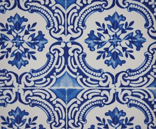 Azulejos Wallpaper A beautiful tile effect wallpaper with an authentic faded effect in blue on white.