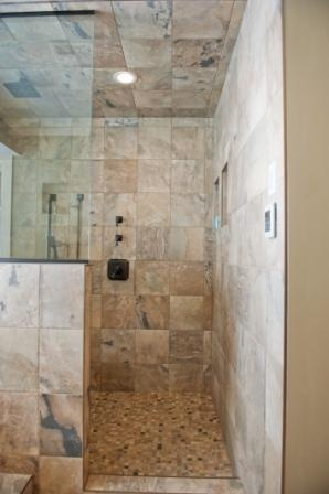 Multiple shower heads + gorgeous tile + lots of space = the perfect shower!