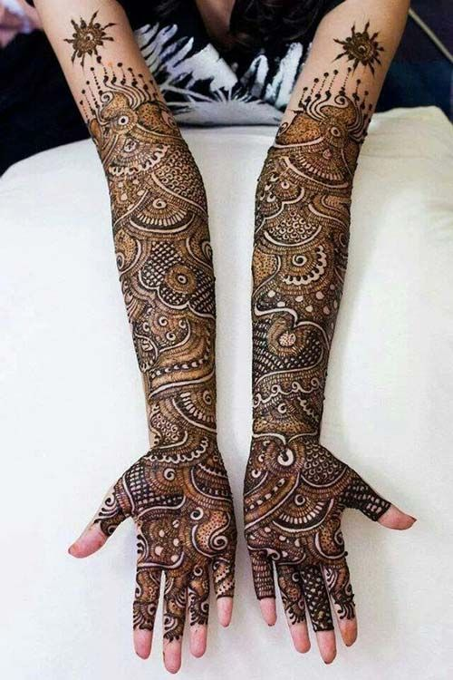 This gorgeous design can make anyone gaze in awe. It definitely needs patience from both, artist and bride, to create such detailed and neat design.