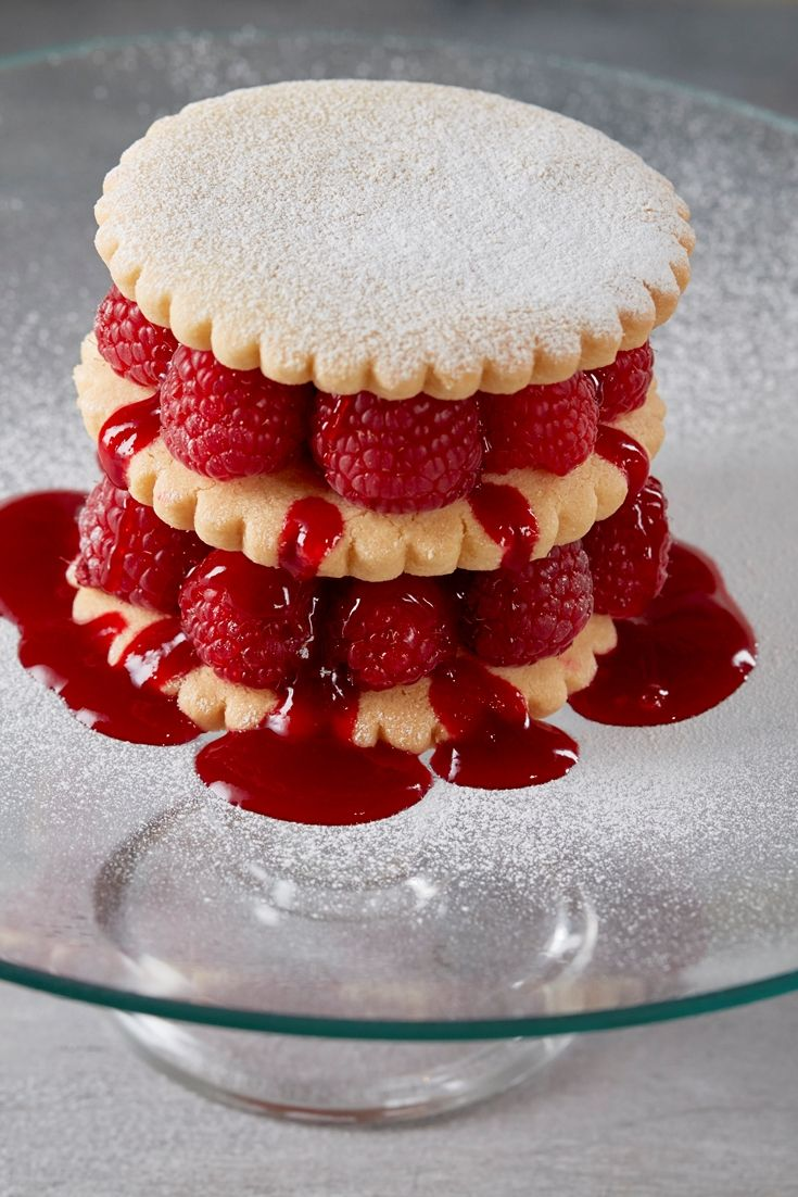 A fantastic layered raspberry shortbread stack recipe by Steven Doherty, with crisp biscuit, fresh berries and a tangy raspberry sauce. This raspberry dessert is simple to prepare, for an impressive but easy dessert.