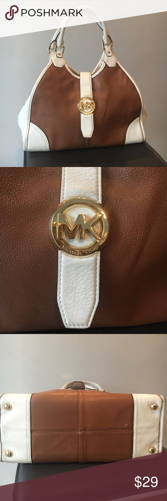 Michael Kors purse Beautiful Michael Kors purse. Stain inside and pealing strap. Great price Michael Kors Bags