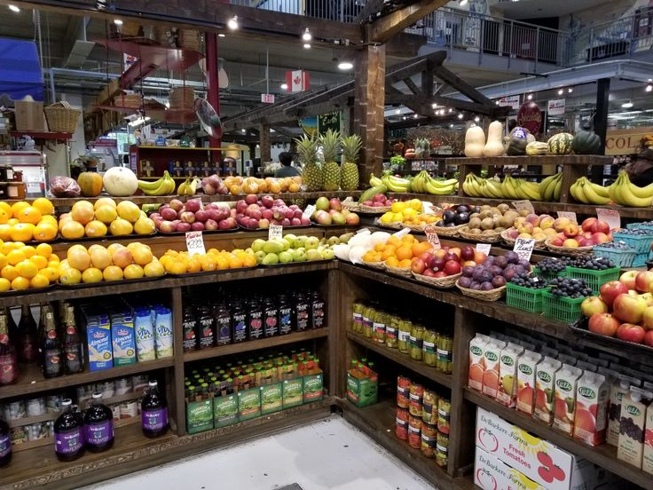 Market fresh fruit, apples, plums, farm to table at a market stall in London Ontario
