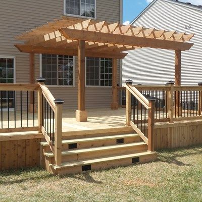 This is a deck with pressure treated decking with cedar rails, trim, and  skirting. One side of the deck contains a pergola that is 12' x 12… - This Is A Deck With Pressure Treated Decking With Cedar Rails, Trim