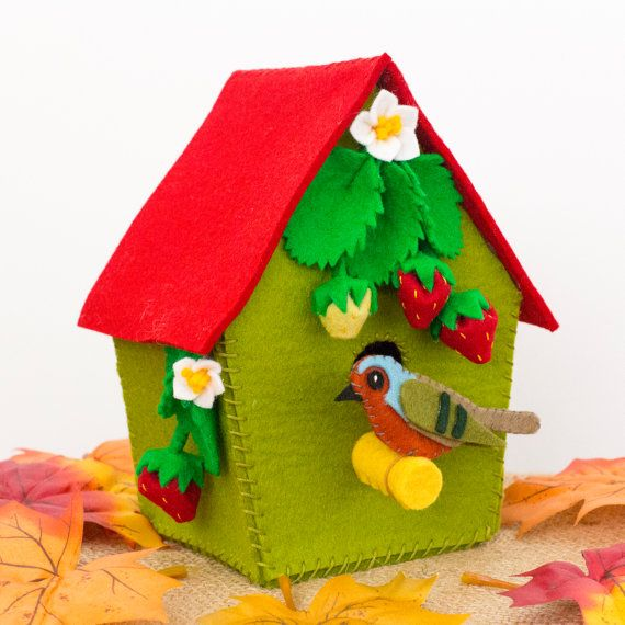 Woodland nursery decorative felt birdhouse with robin, strawberries and strawberry blossoms.