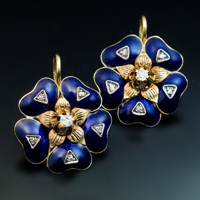 circa 1880 18K gold Victorian era earrings are finely modeled as stylized flower heads covered with royal blue enamel and embellished with old mine cut dia