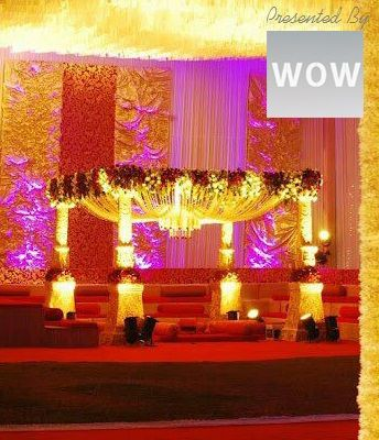 Columns wrapped in flowers and the exquisitely decorated covering above the fireplace in marigold and other & 8 best Best Of Wedding Decoration images on Pinterest | Marriage ...