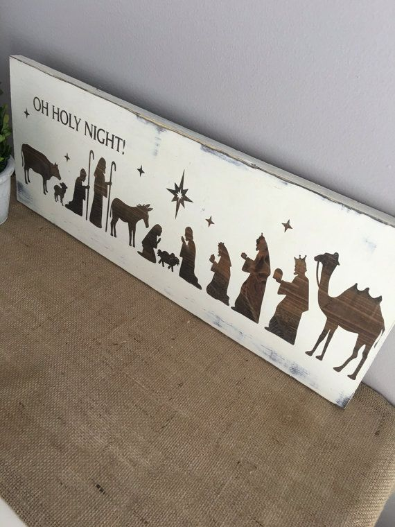 Imagine this beautiful Nativity sign as part of your Christmas mantle display this year and for many years to come. This sign brings the true meaning of Christmas into your home. Sign measures approximately 6X24  Expertly hand cut and sanded to perfection. Made from high grade pine wood. Stained in Antique Walnut gel stain and then painted with Heirloom Traditions French Vanilla chalk type paint. The finish on the sign is suitable for indoor display as well as outdoors. Each sign will have…