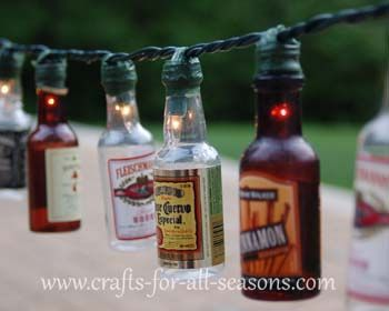 DIY:  .Patio lights made with those miniature alcohol bottles.  I have no idea how to collect enough bottles to make this, but it's a darling idea.