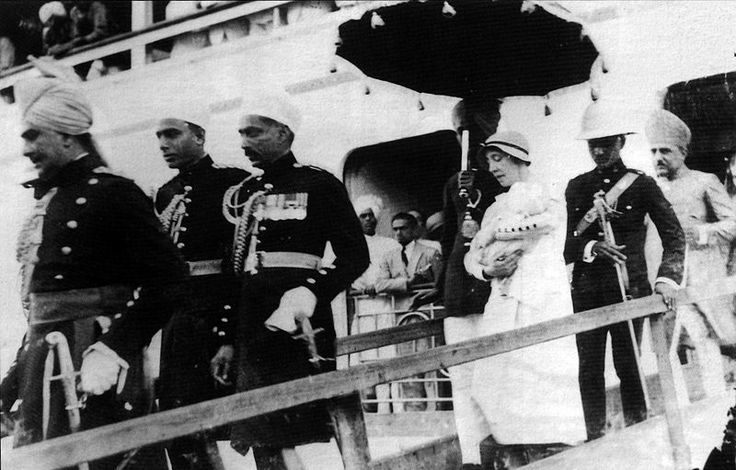 Nanny carrying Prince Mukarram Jah from board after arrival in Bombay, 1934