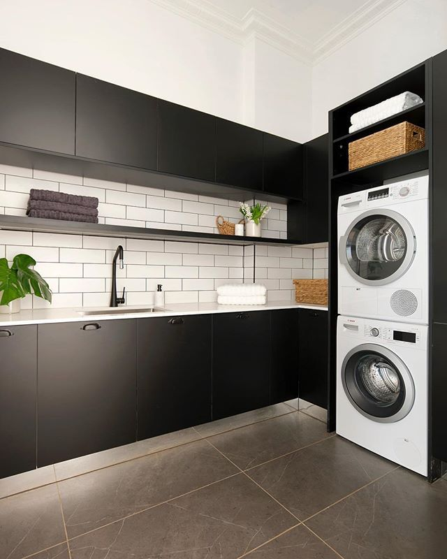 Clean up with this modern & chic laundry design by @kimandchris - loads of storage and classic black & white colour palette #freedomkitchens #laundry #9theblock #blackandwhite #design