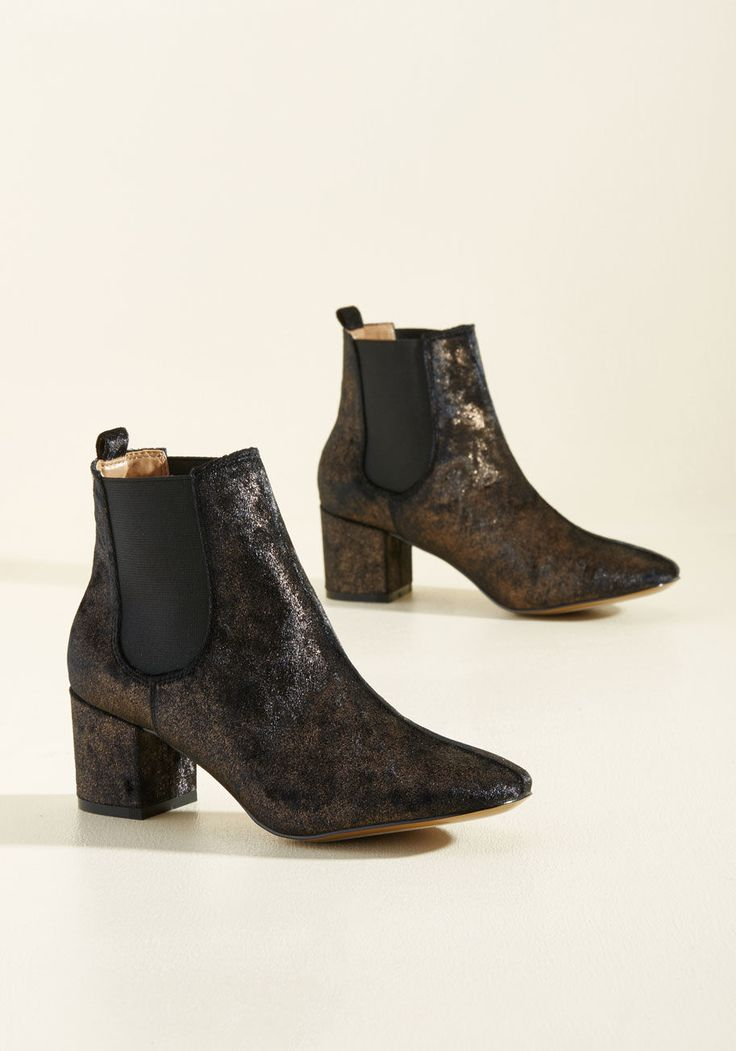 <p>Step onto the scene in these crushed velvet booties by Report Footwear and show the city your mastery of luxe looks. Sleek, elasticized paneling, block heels, and metallic gold flecking boost these noir beauties with a boldness you'll be eager to take out.</p>