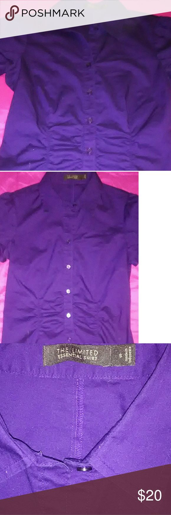 Purple top by The Limited Really cute purple womens top is a button down. Its made adorably.  Its called the Essential Shirt.  Its kind of gathered at the waist and on the back. The shoulders are cuffed and shorter sleeves but not sleeveless. Only worn once. The Limited Tops Blouses