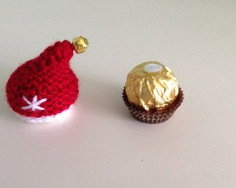 Santa's hat hand knitted to cover a Ferrero Rocher chocolate.