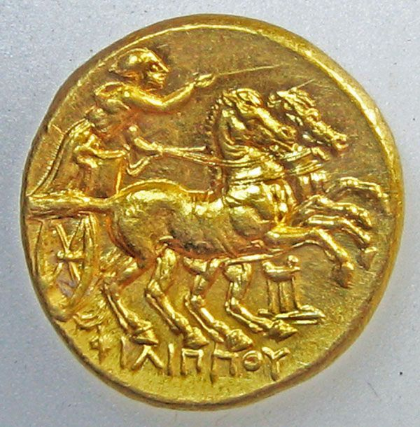Greek gold coin charioteer
