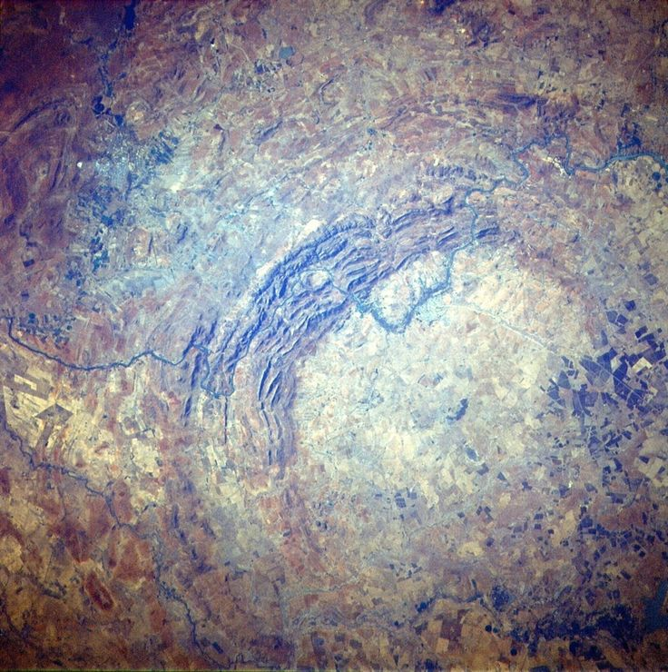 The oldest impact crater on Earth is also the largest. Vredefort crater in South Africa, also called the Vredefort Dome, was originally 185 miles (300 kilometers) across, scientists estimate. A meteorite or asteroid bigger than South Africa's Table Mountain blasted out the giant crater 2.02 billion years ago.