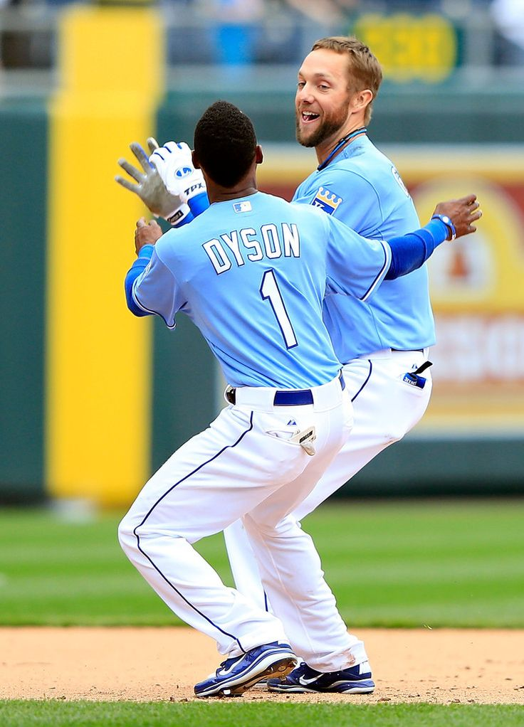 Alex Gordon #4 of the Kansas City Royals is congratulated by Jarrod Dyson #1 after knocking in the game-winning run during the 9th inning of the game at Kauffman Stadium on April 14, 2013 in Kansas City, Missouri. (April 13, 2013 - Source: Jamie Squire/Getty Images North America)