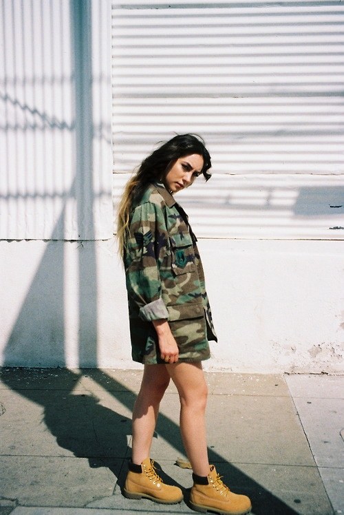 Timberlands and an Army jacket