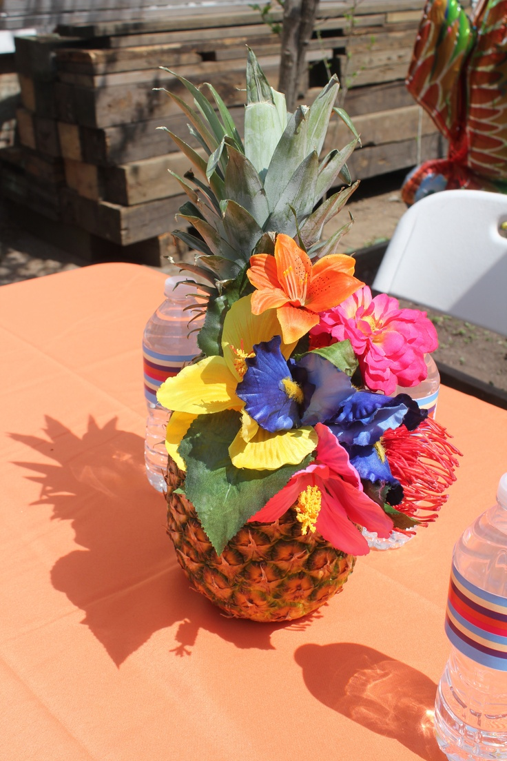 Rio Birthday- pineapple with tropical flower centerpieces