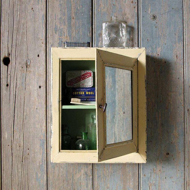 Vintage Bathroom Medical Cabinet // 1920s. A vintage tinplate bathroom medical cabinet with mirrored door. Original external paintwork, but repainted internally. Fixes to wall with screws accessed from inside the cabinet. Some foxing to mirror.